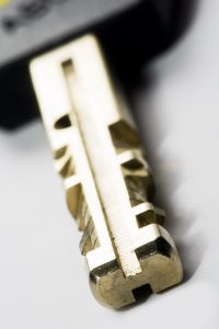 key with shallow depth of field on grey background